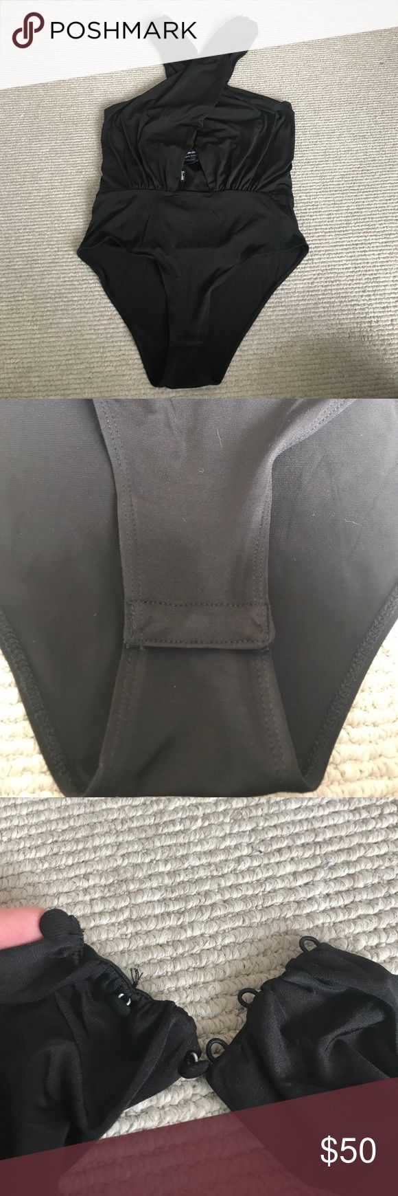 NWT Bardot Wrapped Up Body Suit Black body suit with opening on upper stomach. Wrap around halter with 3 button closures. Never worn. Size medium good for sizes 4-8 in my opinion. Lots of stretch and give all over. Claps closure underneath. (But you can step into it as well). Bardot Intimates & Sleepwear Bandeaus
