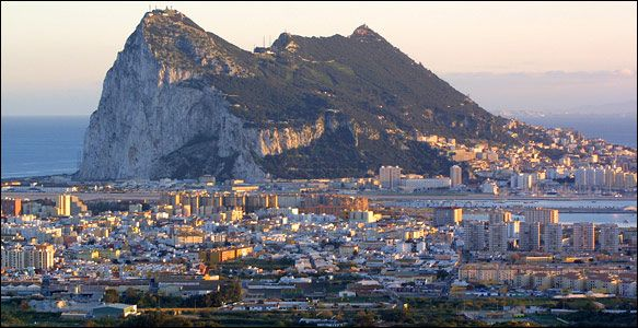 Rock of Gibraltar -  the single massive 1,396-foot-high boulder is sheer on one side, with a city of 30,000 clinging to the bottom third of the other side