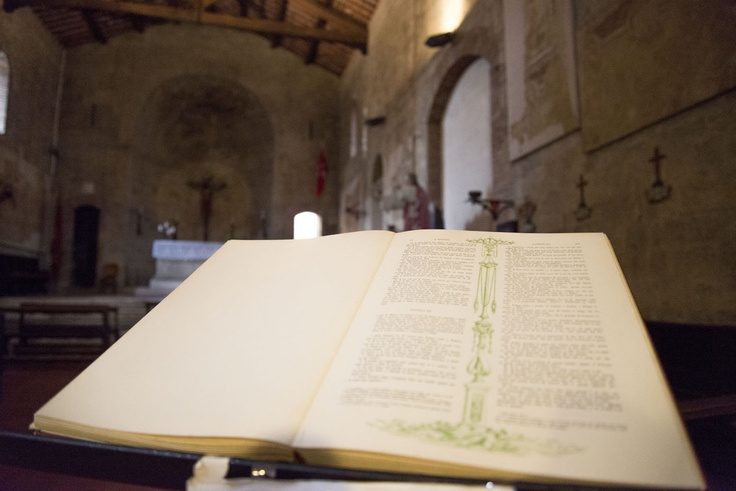 Toscana, Italy. An old book in old church in Siena.