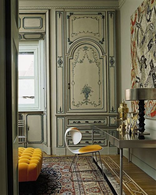 In this 1920s Milan apartment, a saffron-hued chair by 21st-century designer William Sawaya takes center stage. Image by Armando Bertacchi.