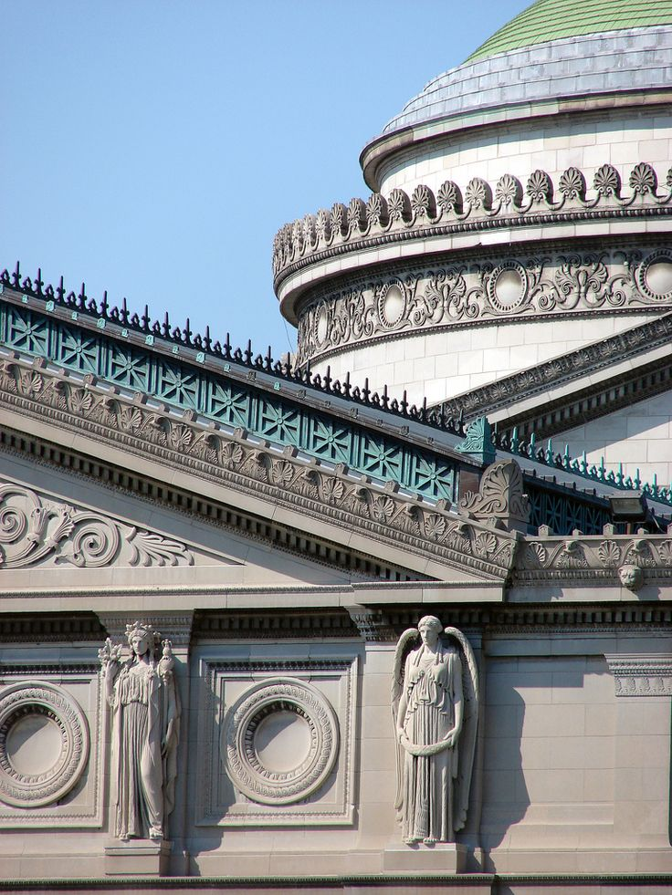 Museum of Science and Industry Chicago, Illinois, USA  The Chicago Museum of Science and Industry is housed in what was originally the Palace of Fine Arts building from the 1893 Chicago World's Fair (World's Columbian Exposition).  This is a detail shot of part of the roofline and dome showing the intricate trim and decorative statuary.  The Palace of Fine Arts (also known as the Fine Arts Building) at the 1893 World's Columbian Exposition was designed by Charles B. Atwood. Unlike the other…