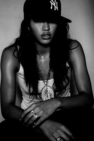 Cassie.  Yankee fitted and a wife beater.