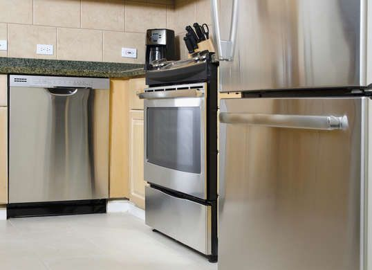 Stainless Steel Contact PaperIf you like the look of stainless steel but don't have the cash to upgrade your kitchen appliances, here's a clever workaround. Apply elegantly economical contact paper, which comes in a range of colors, including stainless steel. The budget adhesive can be acquired for under $10, cut to size with a razor blade, and adhered to ovens, microwaves, and other ordinary appliances to give your kitchen a modern, metallic facade. Cost: $10.