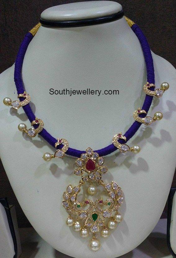 Blue Dori Necklace with Peacock Pendant