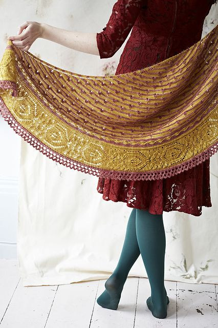 A crescent shaped shawl with picot stripes and a lace edging that's simply stunning.