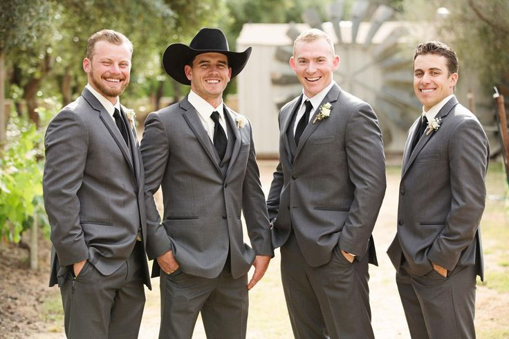 Charcoal gray tuxedo, black tie, cowboy hat, groomsmen style // Aaron Huniu Photography