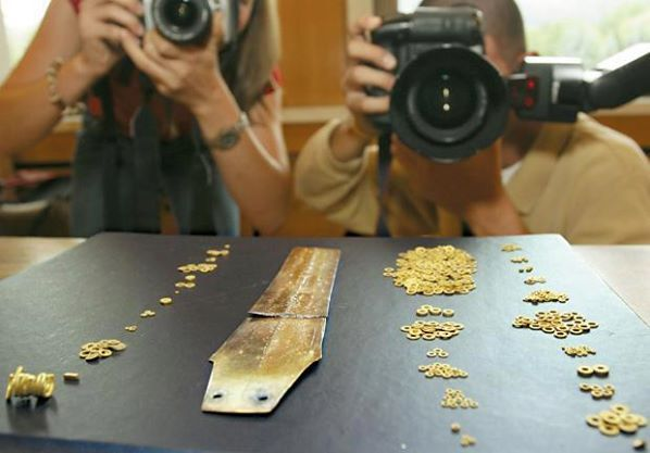 A 4200-year-old golden hoard, comparable to the fabulous treasures of Troy, has been discovered in Bulgaria to the delight of archaeologists desperate to outdo looters in the Balkan state. The miniature pieces were unearthed in an ancient tomb in Dabene, 120 kilometres east of the capital, Sofia. The objects, including 15,000 ornate golden rings, may have been made by a race predating the ancient Thracians.