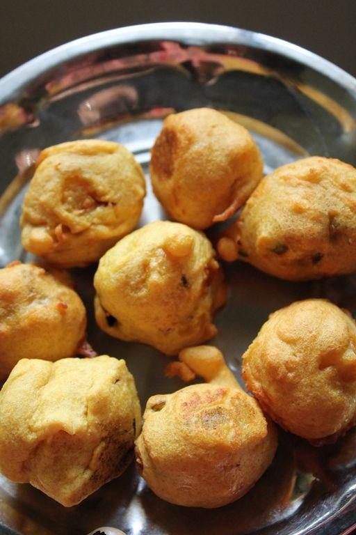Aloo Bonda / Urulai Kilangu Bonda  Boiled seasoned potatoes dipped in chick pea batter and deep fried.