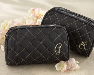 """As indispensable as make-up itself, a girl's make-up bag should be as stylish as she is. Our """"Cosmetic Couture"""" Quilted Make-Up Bag takes the phrase """"fashion-forward"""" to a higher level. The make-up bag makes a fantastic bridal shower favor, but pair it with its companion, the """"Knotted Couture"""" Quilted Tote Bag, and you have a bridesmaids gift worth giving!"""