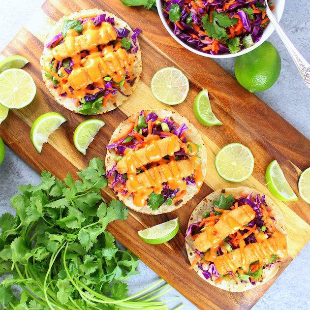 Bang Bang Fish Tacos – a delicious well-balanced meal! With lightly toasted corn tortillas, citrusy cabbage slaw, fish sticks, & yummy Bang Bang sauce!
