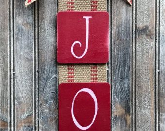 25 long, 5 wide, features rustic webbing background, burlap bow and red berry embellishment as shown (embellishment may vary slightly from that shown). Can be custom ordered to have other words (price may vary). Comes with attached jute tie for hanging on the wall or as a wreath alternative.