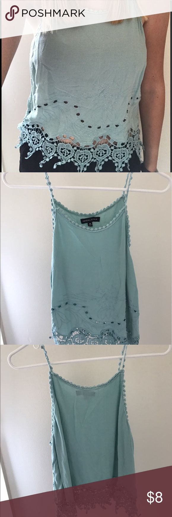 Kendall + Kylie Top Kendall + Kylie crop top purchased at Pacsun. Fits to dark high-waist jeans or skirts. I'd suggest to wear a strapless bra as the straps are very thin and beautifully detailed! Kendall & Kylie Tops Crop Tops