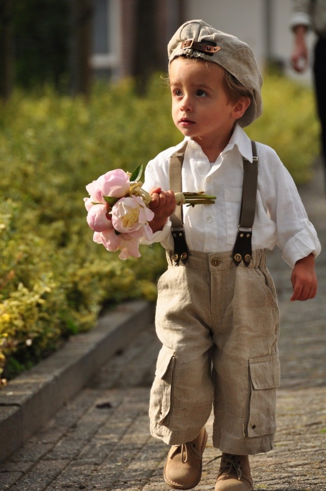 So cute: ring bearer with suspenders and cap!