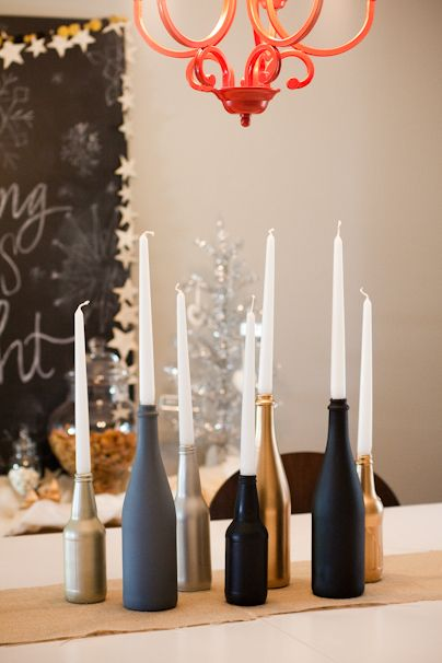 Spray Paint bottl candle holders.  Cheap, easy.