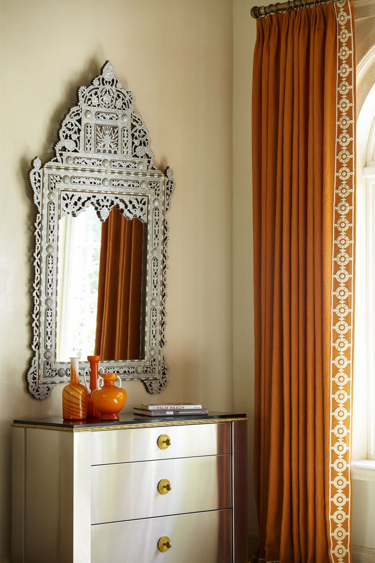 Burnt orange curtains with embroidered border -- interior design: Cullman & Kravis