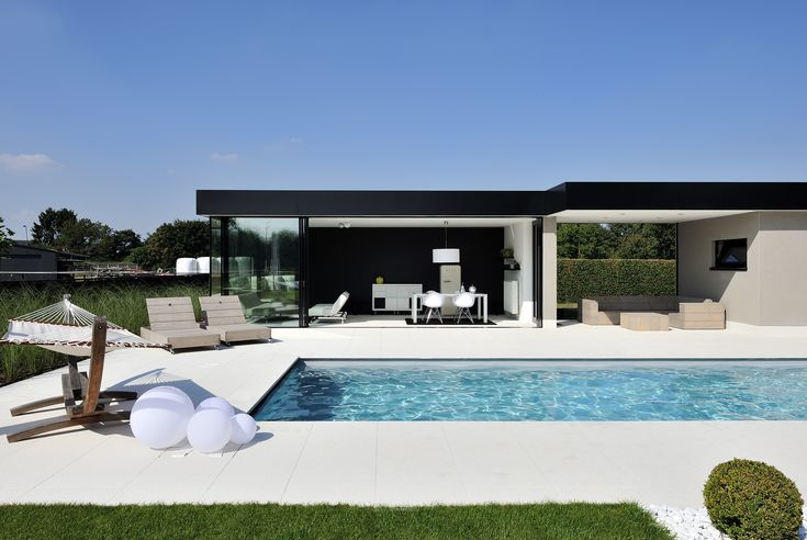 Sliding minimal windows to a modern pool side living room, the