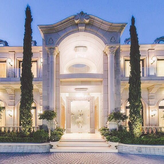 luxury mansion with a grand entry and