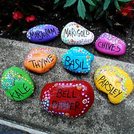 Rocks and outdoor paint is all you will need to create these colorful garden markers that withstand the elements!