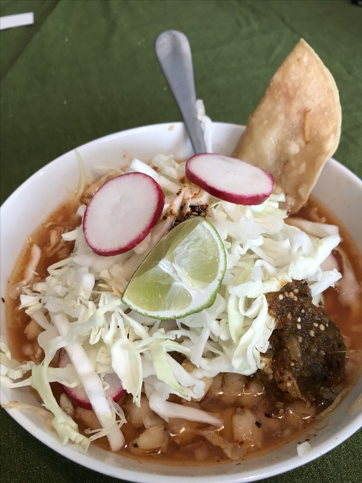 Pozole...great meal to kick start Fall coming around the corner. Pork shoulder, pork bone, hominy, chile árbol, garnish with cabbage, radishes, finely diced yellow onion, and squeeze on some line. If you want a recipe let me know!
