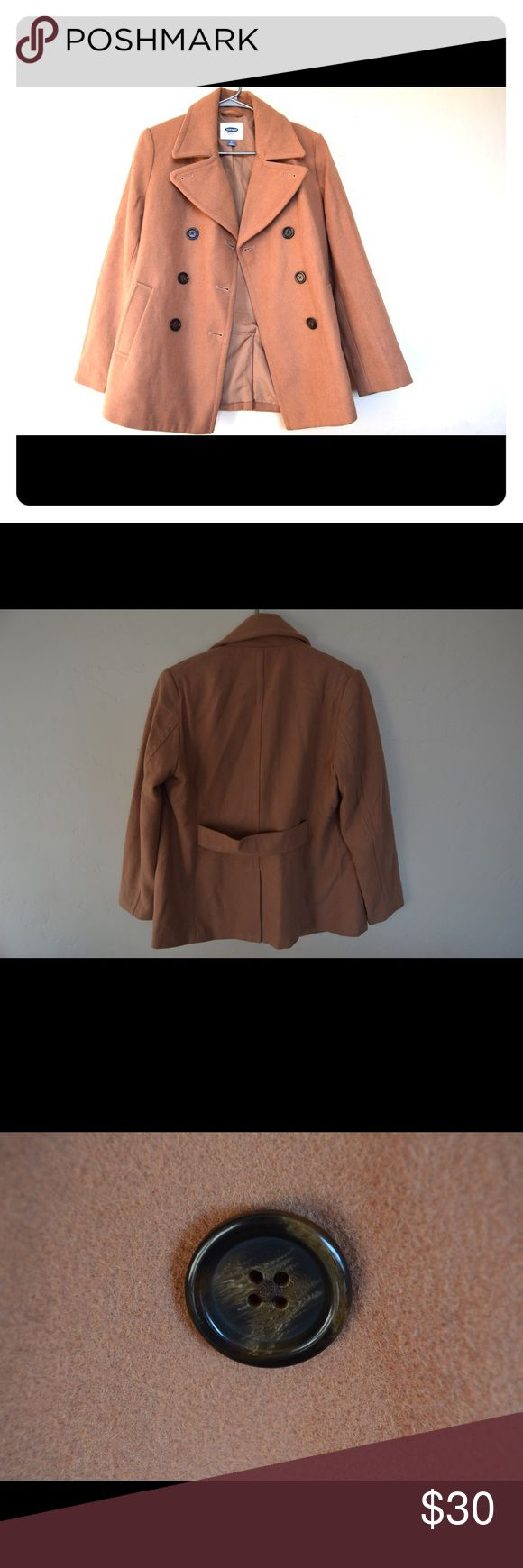 Camel Old Navy Pea Coat Beautiful camel colored pea coat from Old Navy. Only worn twice. Bought it thinking I'd wear it but didn't need it since I moved to a warmer climate. The color is most accurate in the first photo. Beautiful color and matches a lot. Would be a great gift. Keeps you warm. Dry clean only. Posted a close up of he buttons to show their detail. The only flaw is a slight thread coming up (photo shown) and that was like that when I purchased it. Let me know if you have any…