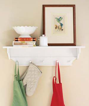 Hang aprons, pot holders, and dish towels on pegs (mount them at least two feet away from the stove).