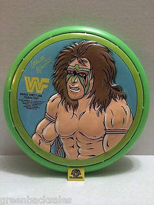 (TAS008428) - WWE WWF WCW Wrestling Ultimate Warrior Frisbee - Green