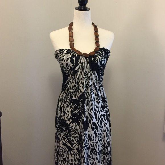 Summer Dress Fun animal print summer dress with wooden halter neckline. Lightweight, stretch material. Good condition!! Forever 21 Dresses
