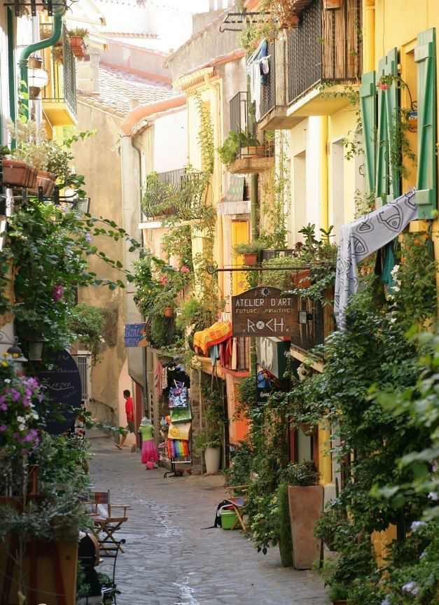 Street line shops in France. So relaxed and intriguing. I would love to just be strolling the street with a warm drink browsing these shops