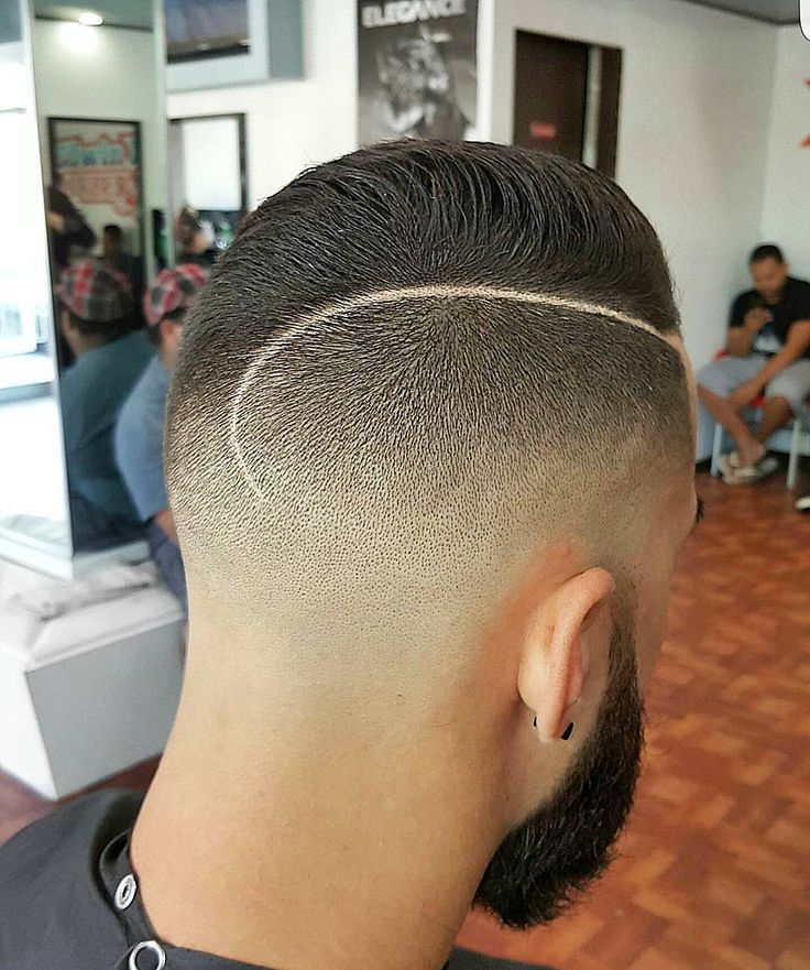 Clean fade with a nice part.
