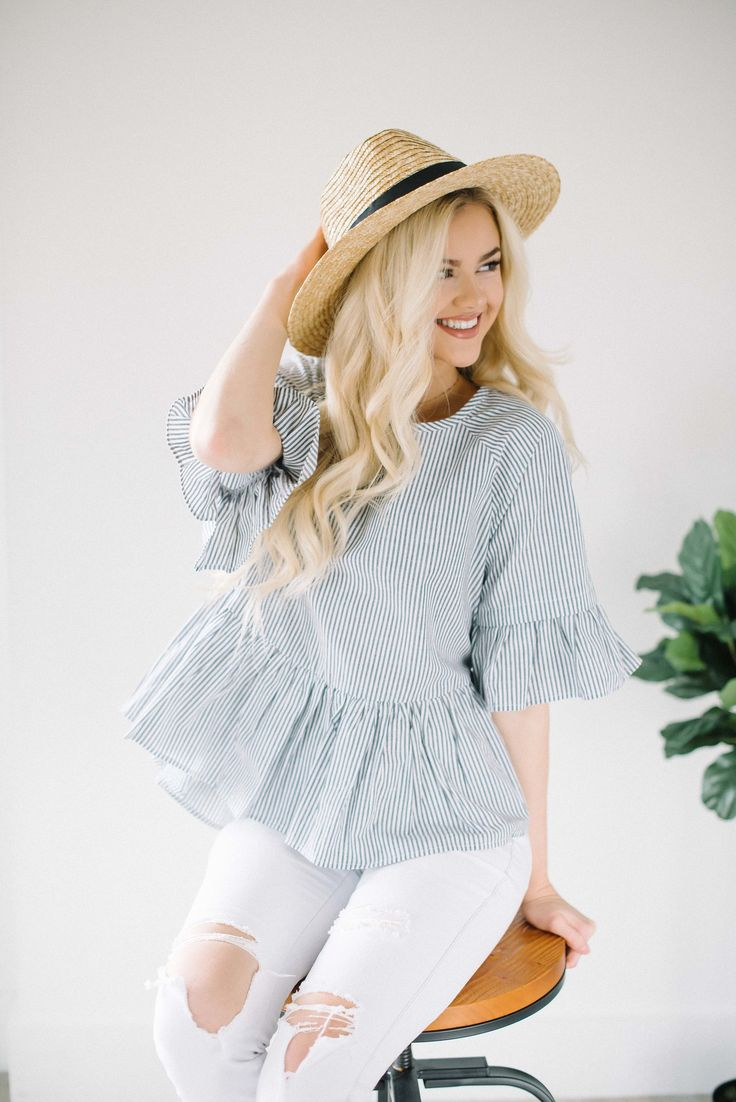 "- Grey stripe ruffle top - Half sleeves with bell - Crossover straps on back - High low styling - Over sized fit - 100% cotton - Hand wash only Model is 5'8"" + wearing a small"