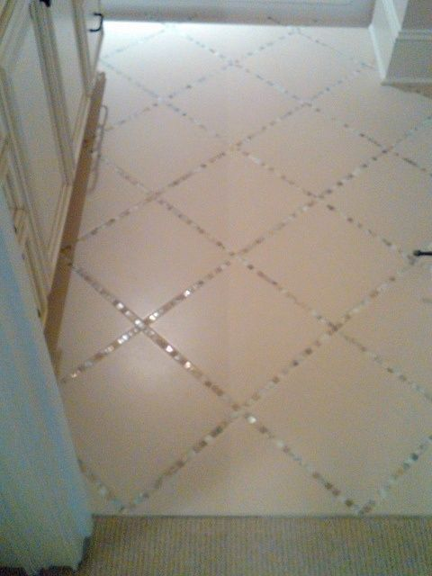 """Lay a thin strip of """"backsplash"""" tile in between the large tiles, instead of just using grout..to blend that kitchen backsplach to the floor! ... Unexpected"""