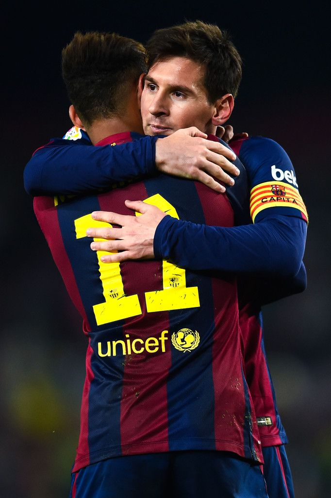 Lionel Messi of FC Barcelona celebrates with his team-mate Neymar of FC Barcelona after scoring his team's third goal during the Copa del Rey Round of 16 First Leg match between FC Barcelona and Elche CF at Camp Nou on January 8, 2015 in Barcelona, Catalonia.