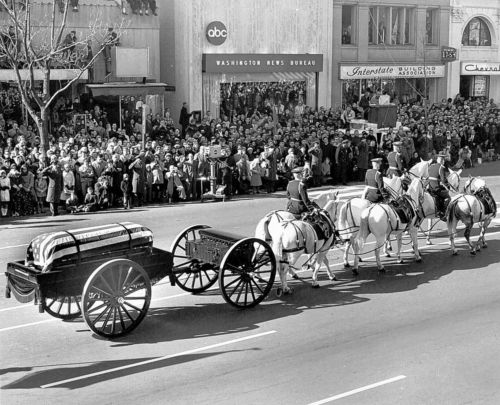 The caisson bearing U.S. President John F. Kennedy's flag-draped casket is drawn by horses in a procession to the Cathedral of St. Matthew the Apostle in Washington for the president's funeral Mass. (CNS photo/courtesy Catholic Standard)