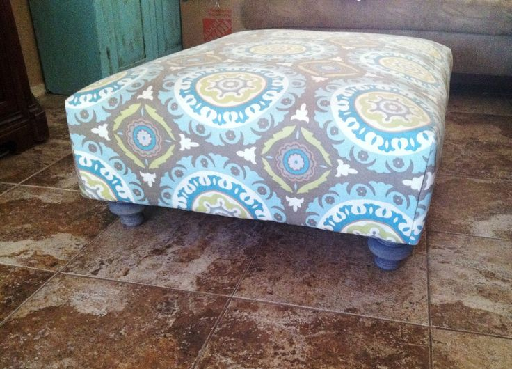Easy pallet ottoman in 4 simple steps! 1. Screw two pallets together 2. Cover in three layers of batting. 3. Wrap fabric like a present and staple. 4. Add super cute legs