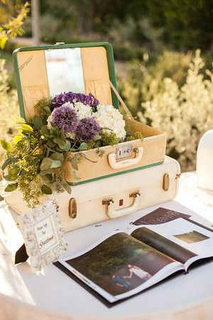 Flowers in suitcase decor.  #traveler #wedding #idea