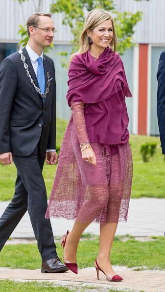 The stunning Dutch Queen Maxima beamed as she arrived at the 12th edition of Burendag. She wore an elegant purple dress from Belgian designer Natan for her visit