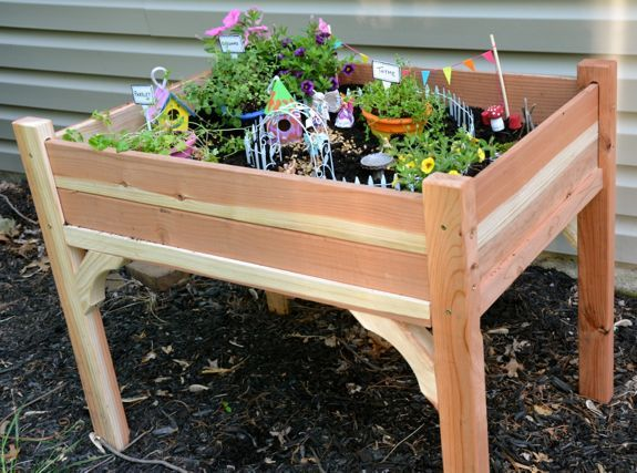 How cute would this be!?! When the girls are a little older for them to do this on their own. Fairy Garden Table