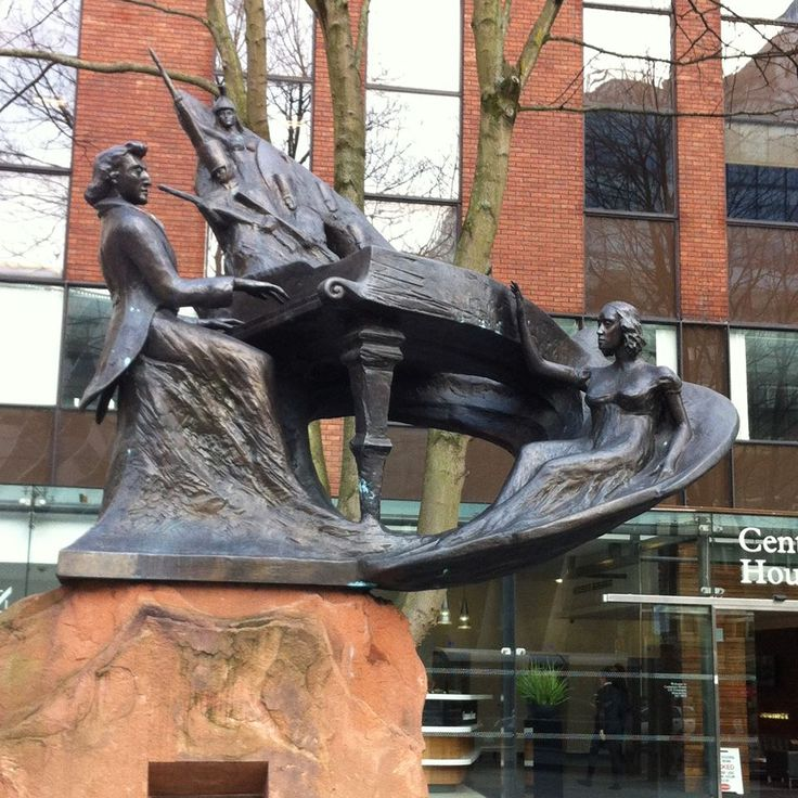 Chopin with a lady on a helter skelter and an army inside the piano. Deansgate, Manchester.