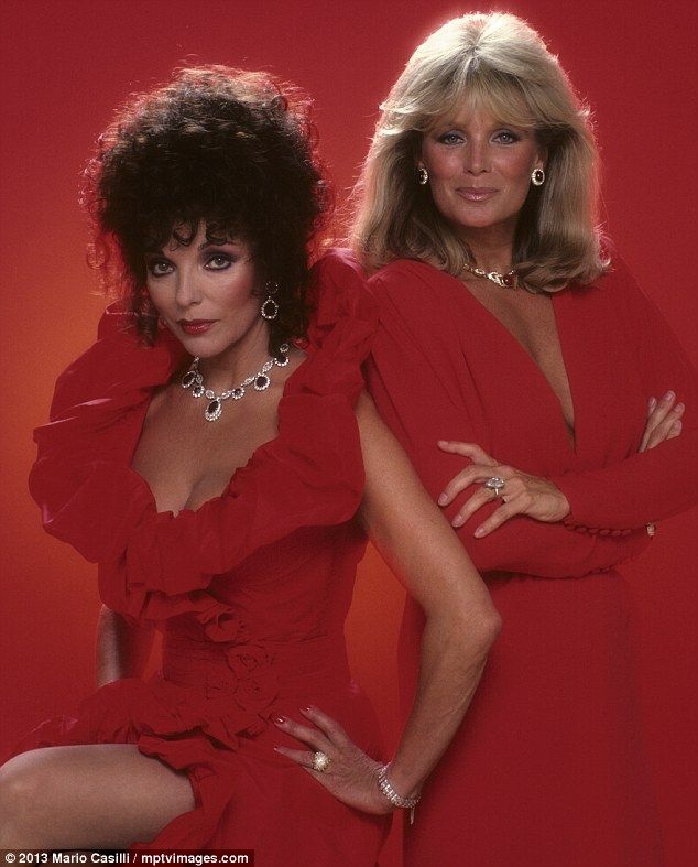 Joan Collins and Linda Evans of Dynasty working dramatic full make up, lots of jewels and tomato red