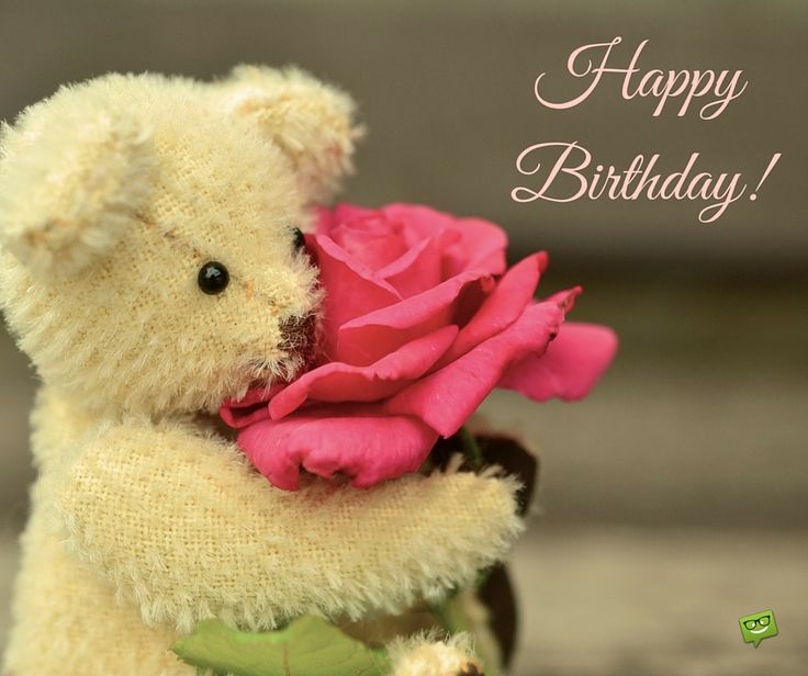 Happy Birthday on cute image of little bear toy holding a rose.