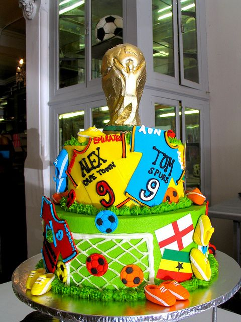 2-tier Wicked Chocolate cake decorated with soccer world cup fondant decor & 3D gold trophy cake topper by Charly's Bakery, via Flickr