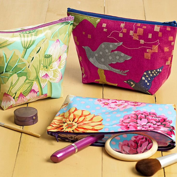 Sew a few seams and insert a zipper (we'll show you how) to make each of  these cute pouches in very little time.