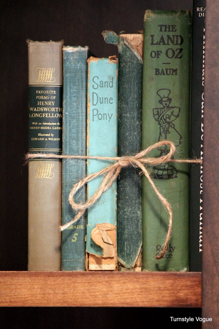 Interesting way to bookend old books on shelves.  Great for old kids books too.