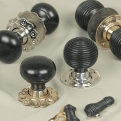 THE REAL MCCOY- SOLID EBONY DOOR KNOBS  Black Country brass hardware retailer MDS has launched a new range of solid ebony door knobs. The company will start by offering two designs - an elegant Victorian Beehive knob with matching escutcheon and a classic Edwardian Bun knob.