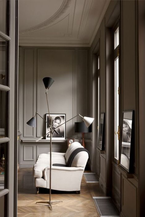 Beautiful paint color, sofa, floor lamp