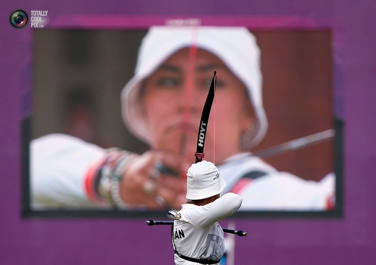 Mexico's Aida Roman shoots as she is seen on a large screen during the women's individual archery final at the London 2012 Olympic Games at the Lord's Cricket Ground. SUHAIB SALEM/REUTERS