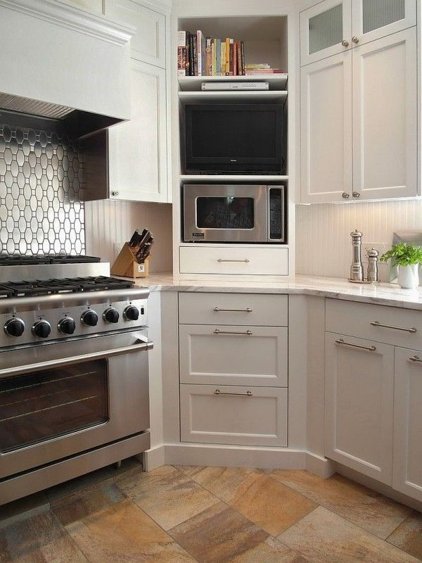 Corner microwave cabinet in the kitchen with shelves above and drawers below