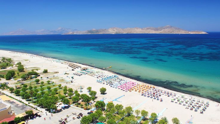 Tigaki Beach on the Greek Island of Kos. This wonderful family friendly beach has a string of groovy cafes, shops and amenities for all the enjoy.