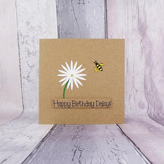 Bee birthday card with pink flower (gerbera daisy). Bee happy on your birthday. The colour of the flower on this handmade birthday card can be chosen from the drop-down menu. The sentiment on this floral birthday card is added with 3D foam and reads: Bee happy on your birthday. You can choose other messages or your own message on this birthday card with a pun (funny birthday card) from the drop-down menu.  This bee card would make a great birthday card for a Mum, daughter, granddaughter…