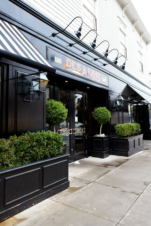 French cafe facade - with black colored panels